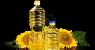 14368236-sunflower-oil-and-sunflower-isolated-on-black